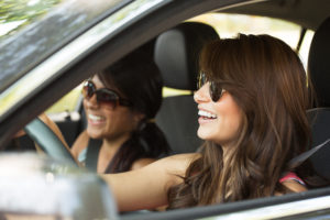 Two girls driving