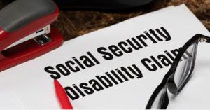 social security disability claims words on a paper with glasses